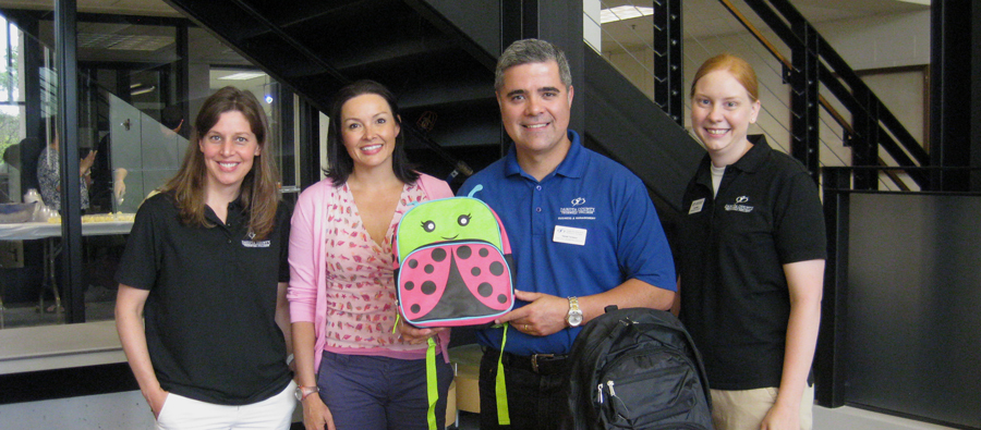 Diversity Council Collects Backpacks for 360 Communities in Rosemount